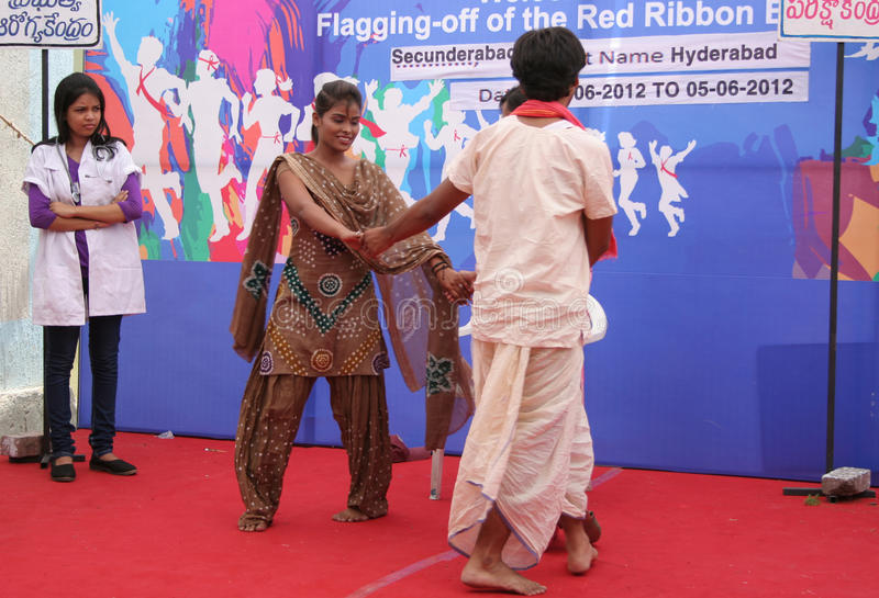 AIDS/HIV awareness campaign-india. Local artists perform street play on visit of Red Ribbon Express to Secunderabad on June 05,2012 in Secunderabad,Ap, India stock photos