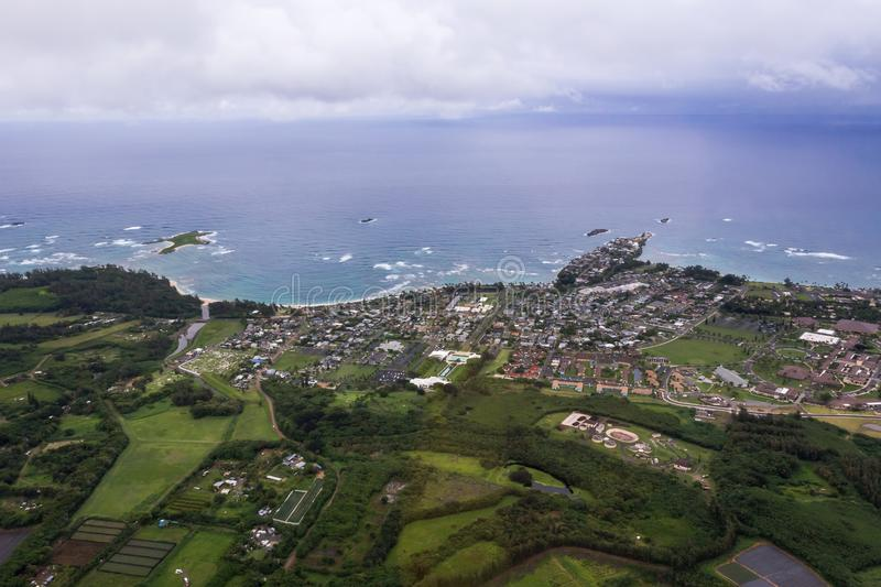 Aierial view of ocean coast and urban area. Aierial view of Pacific ocean coast in Oahu, Hawaii. Ocean shore, urban area and fields stock images