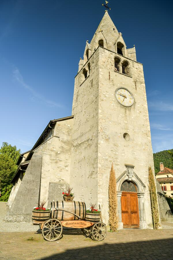 Historic reformed church in city of Aigle, Switzerland. Aigle, Switzerland - June 8, 2019: Historic reformed church in city of Aigle, Switzerland during sunny stock photos