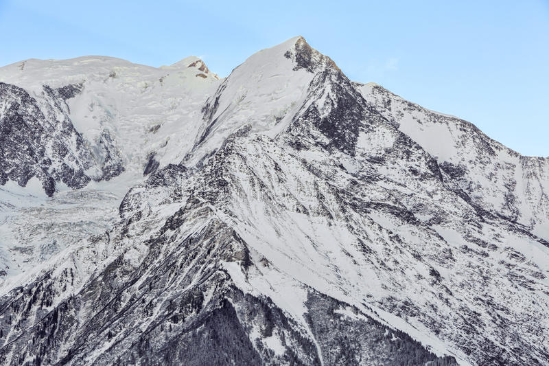 Aiguille de Bionnassay. Winter image of Aiguille de Bionnassay4052m on the west side of the Mont Blanc Massif. In the distance appears Mont Blanc royalty free stock photo