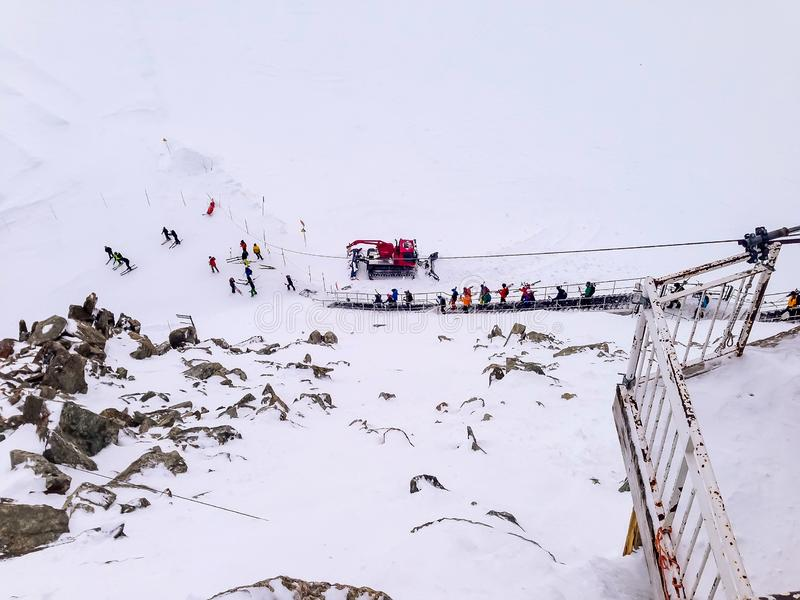 Chamonix Mont-Blanc high lift station, skiers go skiing. Aiguille du midi, France, Chamonix Mont-Blanc high lift station, skiers go downstairs for skiing slope stock photo