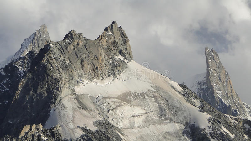Aiguille du Tacul and Dent du Geant. The Aiguille du Tacul foreground, and the Dent du Geant (right) in the Mont Blanc Massif above Chamonix in France royalty free stock photos