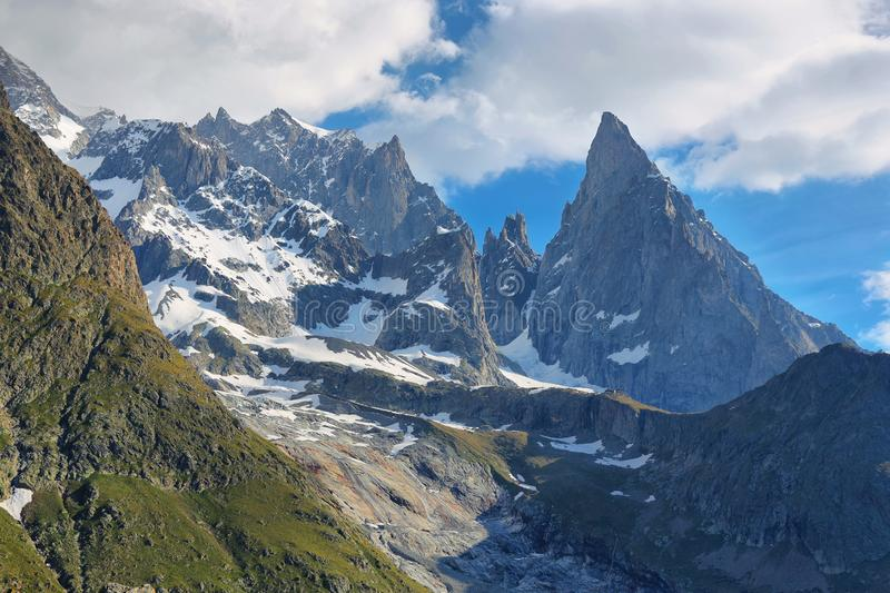 Aiguille Noire peak standing out. Aosta valley, Italy alps. Val Vény, Aosta Valley, Italy. Aiguille Noire peak standing out royalty free stock photography