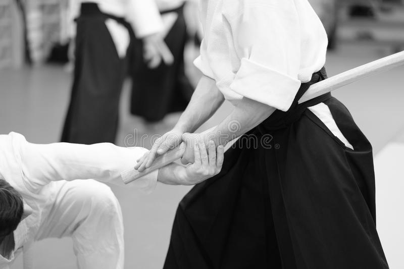 Aikido. The moment of the duel in the martial art of aikido royalty free stock photography