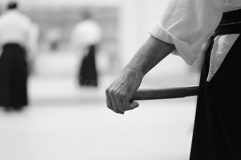 Aikido. Pupil wearing a hakama katana sword before training in the martial arts of aikido stock photography