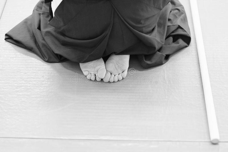 Aikido. Pupil wearing a hakama before training in the martial arts of aikido royalty free stock photos