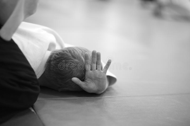 Aikido. Testing of special exercises in training Aikido stock photography