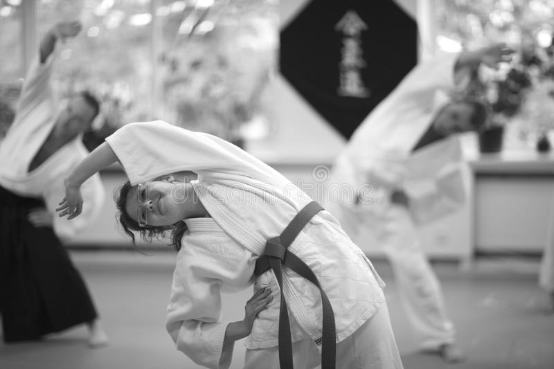 Aikido. Warm-up and stretching of muscles during training Aikido stock photos