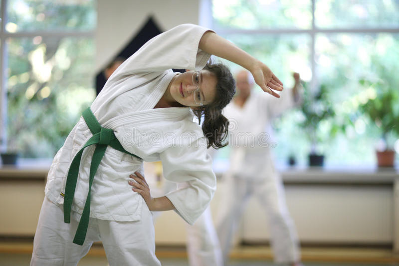 Aikido. Warm-up and stretching of muscles during training Aikido stock photo