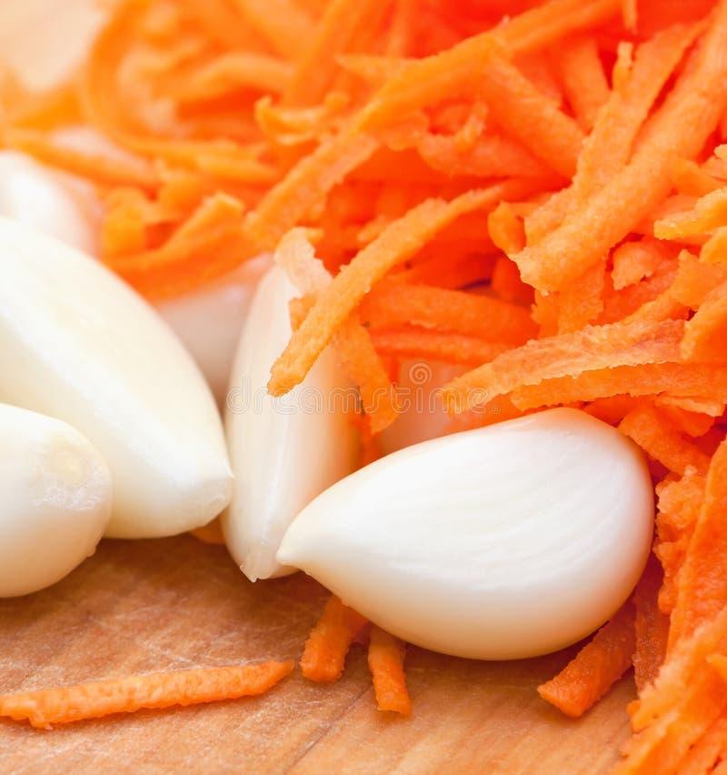 Ail et carotte juteuse images stock