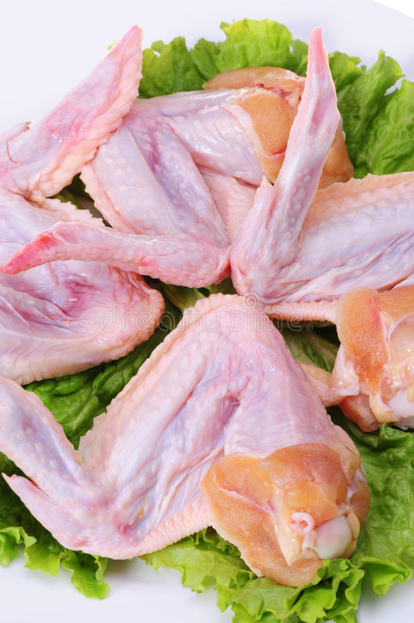 AILES DE POULET CRUES photos stock