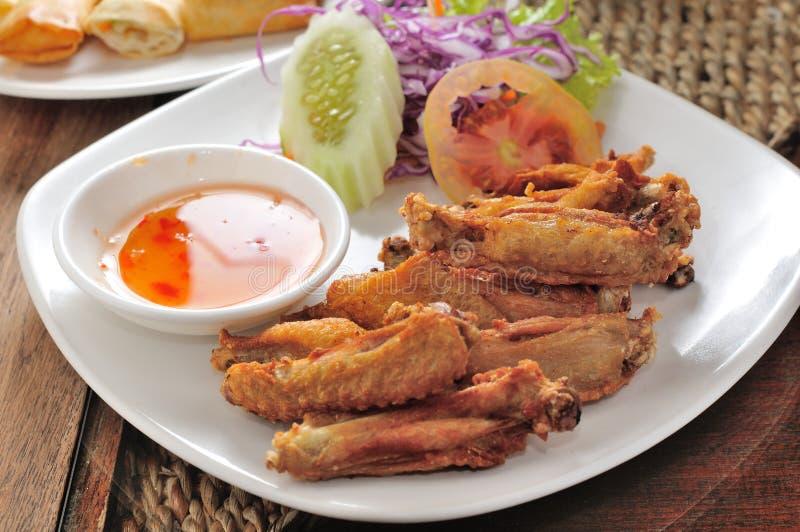 Ailes de poulet frites image stock