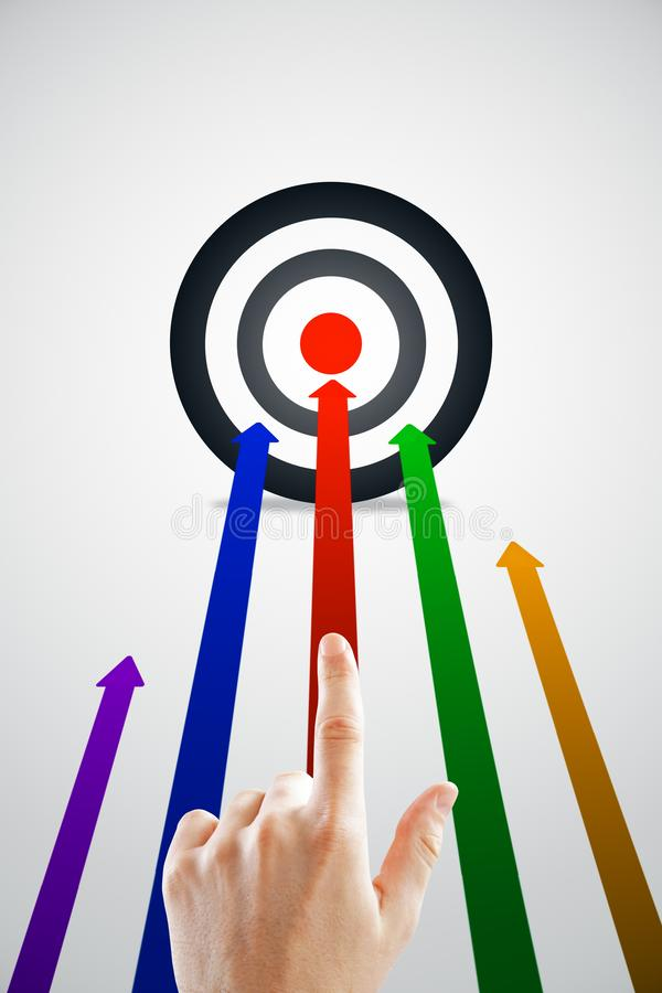 Aim and success concept. Hand pointing at creative background with bulls eye and colorful arrows. Aim and success concept royalty free illustration