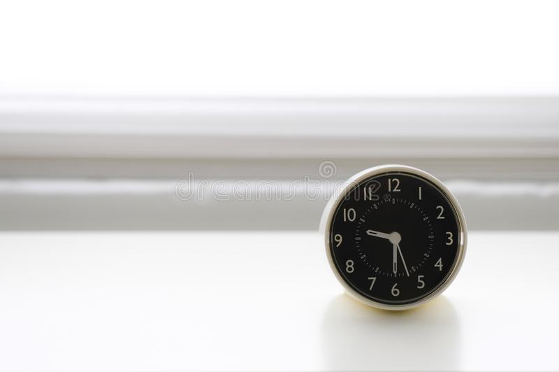 Image of alarm clock in white background. AImage of alarm clock, a concept of limited time, deadline, phase of life stock photography