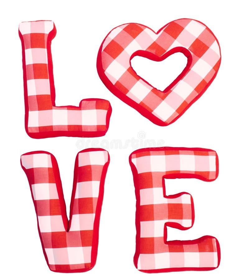 Aimez le mot des lettres rouges de peluche sur le blanc d'isolement images stock