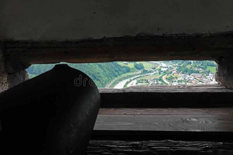 Aiming a canon from Medieval Hohenwerfen Castle in Werfen, Austria. Town of Werfen from canon shooting point at Burg Hohenwerfen or Festung Hohenwerfen,  is a stock images