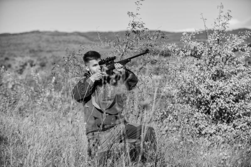 Aiming skills. Hunting permit. Bearded hunter spend leisure hunting. Hunting equipment for professionals. Hunting is royalty free stock photography