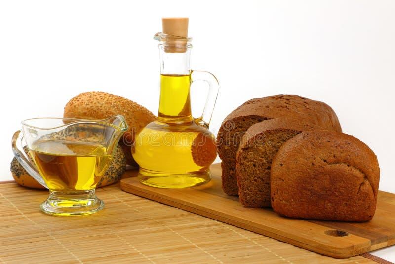Ainda vida com azeite e pão fotos de stock royalty free