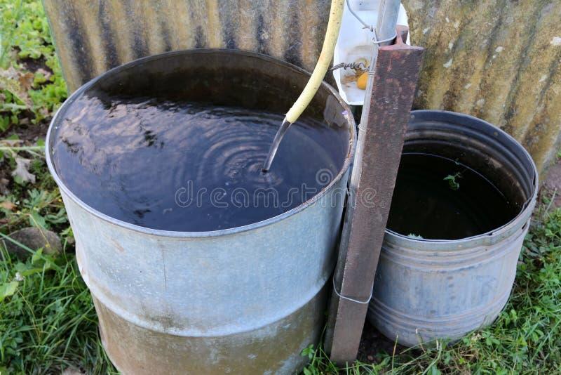 Ainda vida com um tambor da água imagem de stock royalty free