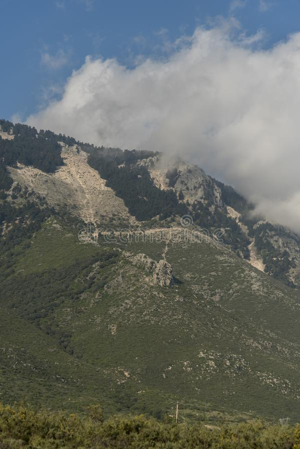 Clouds over Ainos Oros mountain southern Kefalonia. Ainos Oros mountain southern Kefalonia. Kefalonia is an island in the Ionian Sea, west of mainland Greece stock image