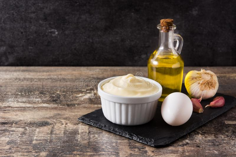 Aioli sauce and ingredients on wood. En table. Copyspace stock images