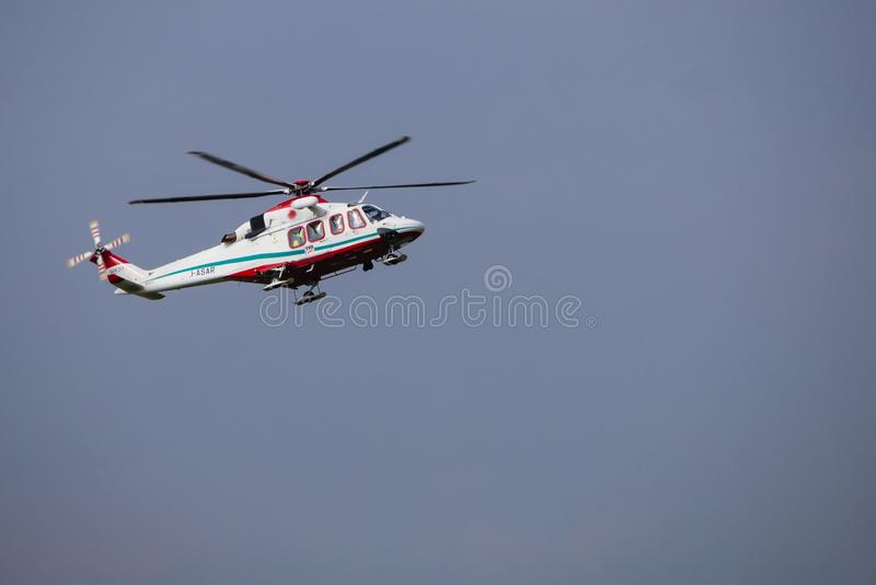 Air Ambulance. Turin, Italy - September 29, 2019: An air ambulance returning to the airfield base after an emergency, at Aero Club Torino, Turin, Italy, aviation royalty free stock photo