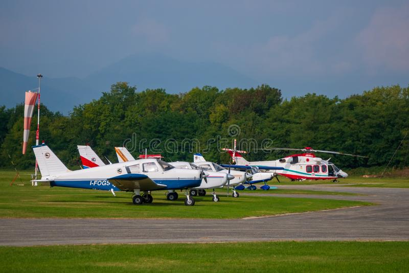 Air Ambulance. Turin, Italy - September 29, 2019: Air ambulance parked next to light weight airplanes, at Aero Club Torino, Turin, Italy, aviation, people, sos royalty free stock photo