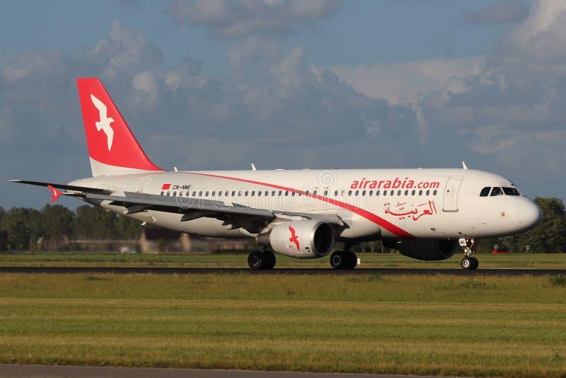 Air Arabia Maroc Airbus A320-214. AMSTERDAM - JULY 01: Air Arabia Maroc Airbus A320-214 lands at AMS Airport in Netherlands on July 01, 2012. Air Arabia Maroc is stock image