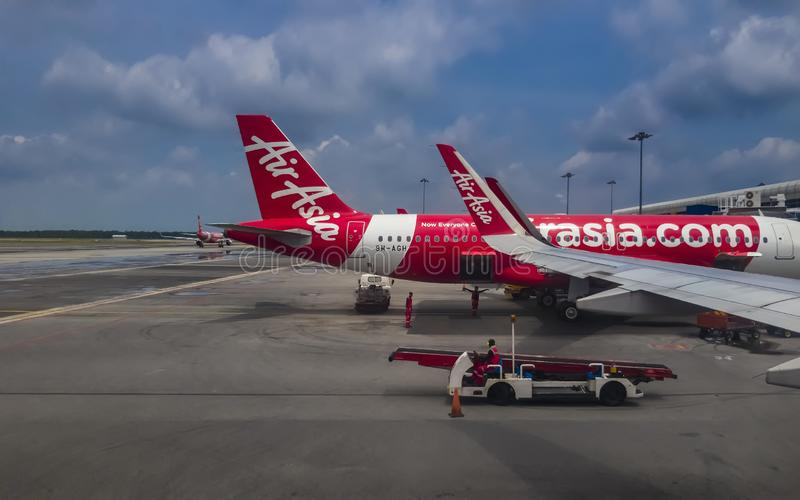 Air Asia Airbus airplane parked at Kuala Lumpur International Airport terminal 2 stock photos