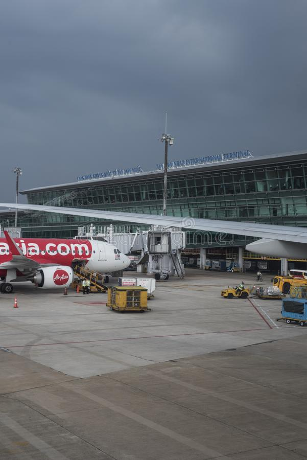 Air Asia plane is getting readied for take off at Saigon airport. royalty free stock images