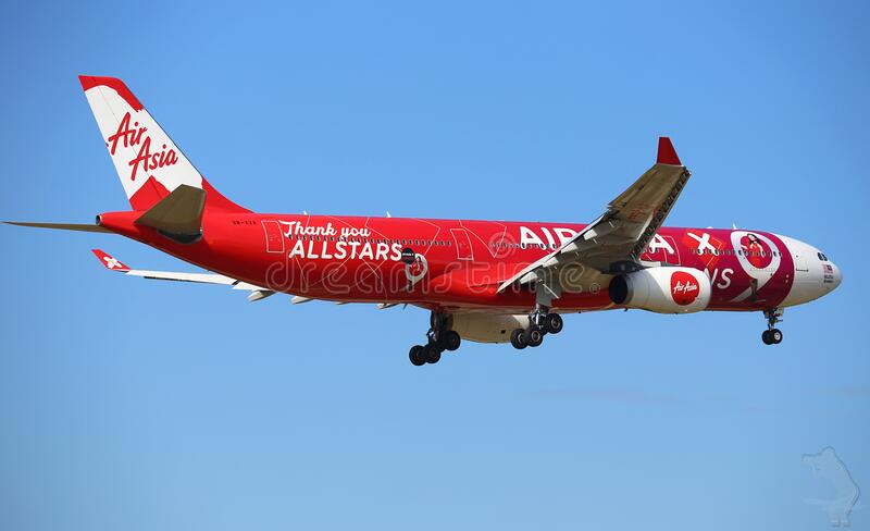 Air Asia plane in sky stock photography