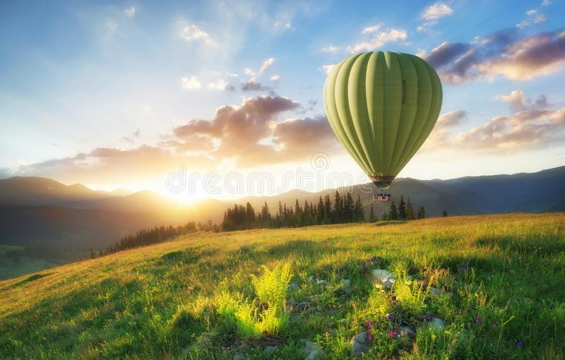 Air ballon above mountains at the summer time. royalty free stock image