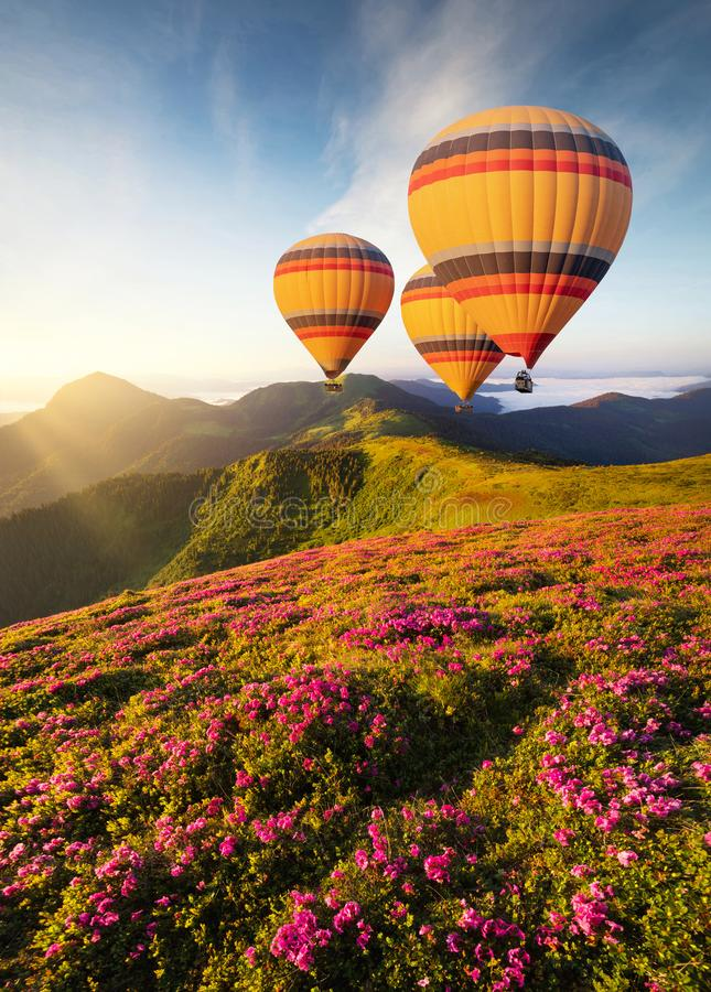 Air ballon above mountains at the summer time. stock photo