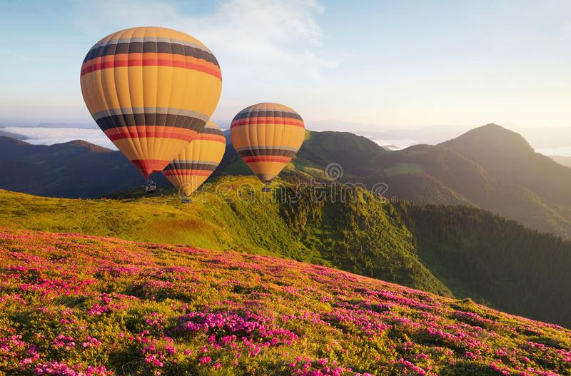 Air ballon above mountains at the summer time. stock image