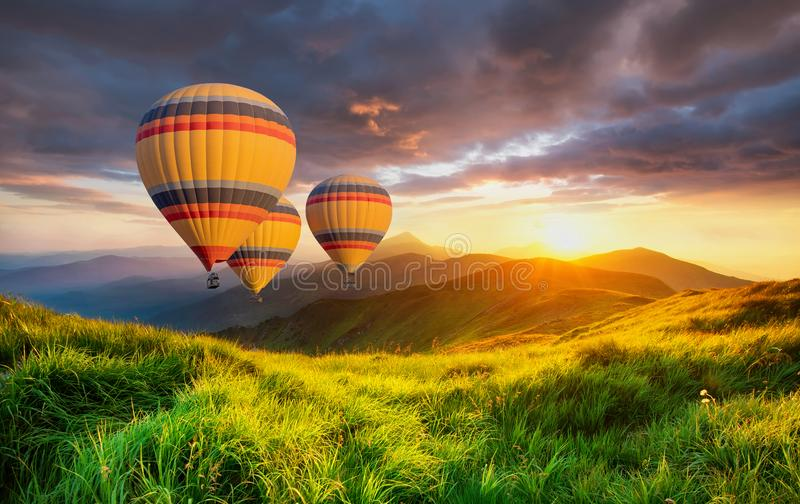 Air ballons above mountains at the summer time. Concept and idea of adventure stock photography