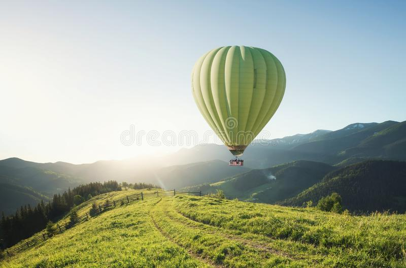 Air ballons above mountains at the summer time. royalty free stock photography