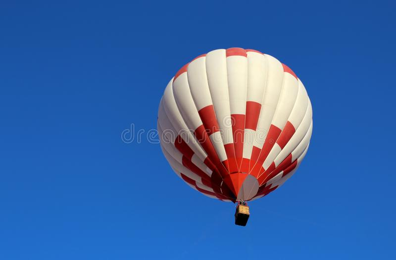 Big balloon with a basket of people. Air, balloon, hot, isolated, background, travel, white, colorful, freedom, fun, transportation, sport, fly, flight, high royalty free stock photography