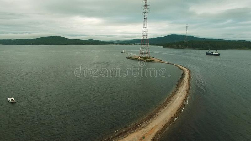 Air the Bay of Vladivostok with the Tokarevsky lighthouse. Sightseeing and tourism royalty free stock image