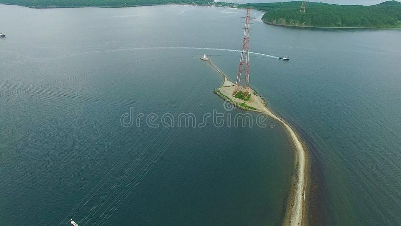 Air the Bay of Vladivostok with the Tokarevsky lighthouse. Sightseeing and tourism royalty free stock photography