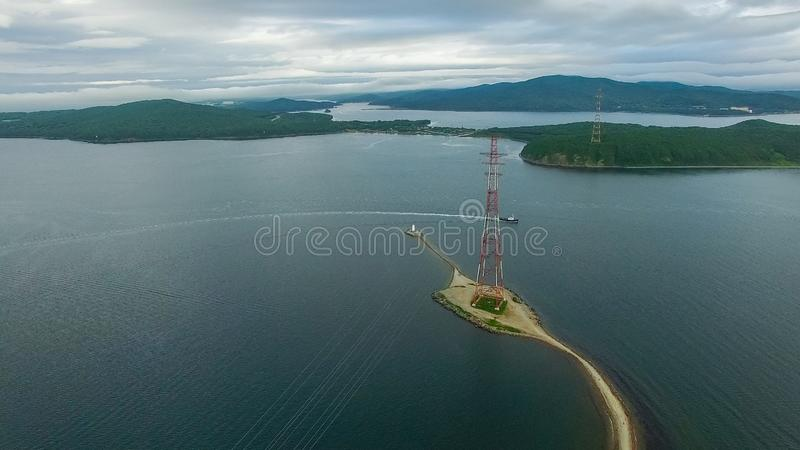 Air the Bay of Vladivostok with the Tokarevsky lighthouse. Sightseeing and tourism royalty free stock photos