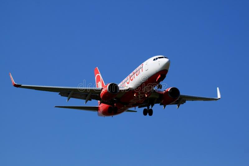 Air Berlin 737-700 landing on 08R on Bucharest INTL royalty free stock photography