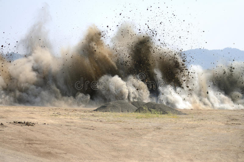 Air Blast. Last blast of rock at a hill removal project to extend an airport runway in Roseburg Oregon stock image
