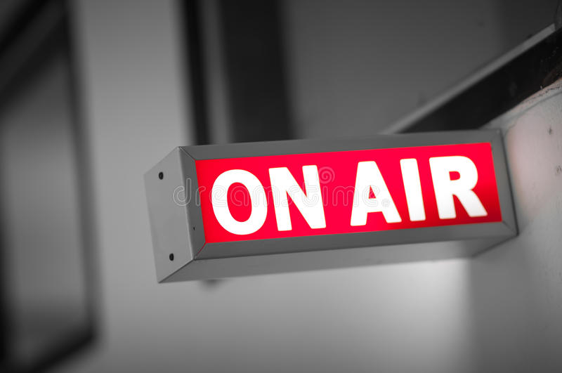 ON AIR board. Message is lit on in studio stock photos