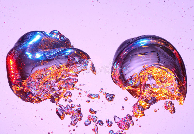 Air bubbles. Close-up of two air bubbles rising in water royalty free stock photo