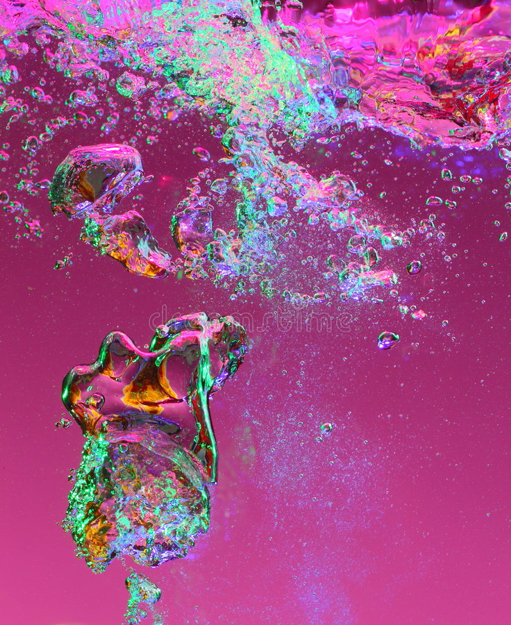 Air bubbles in front of purple. Air bubbles floating in water in front of a purple background stock photos