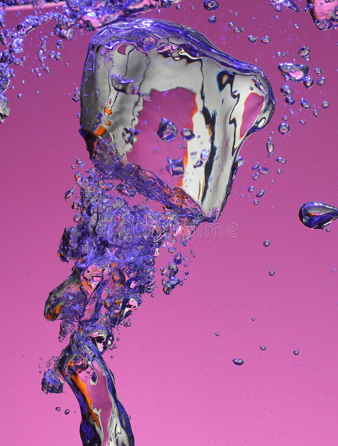 Air bubbles in water. Macro view of air bubbles shattering in water, purple background stock photography
