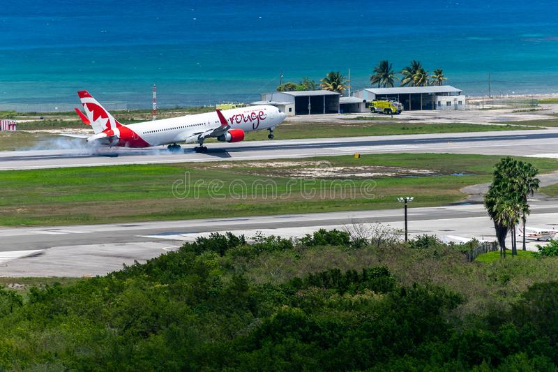 Air Canada aircraft landing in Jamaica. Montego Bay, Jamaica - March 27 2015: Air Canada aircraft landing at the Sangster International Airport MBJ in Montego royalty free stock photo