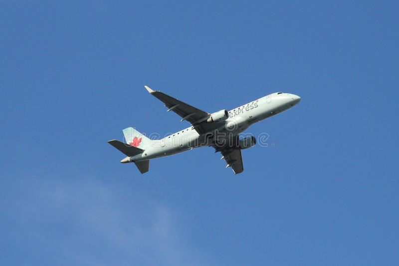 Air Canada Express Embraer ERJ plane taking off from La Guardia Airport stock image