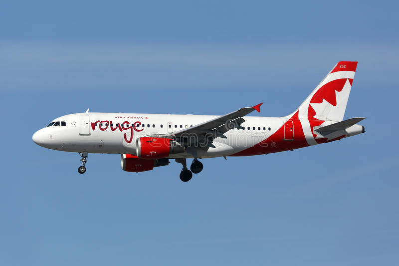 Air Canada Rouge Airbus A319 airplane. Los Angeles, United States - February 19, 2016: An Air Canada Rouge Airbus A319 with the registration C-FYIY landing at royalty free stock photos