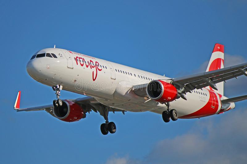 Air Canada Rouge Airbus A321-200 Close Up View. An Air Canada Rouge Airbus A321-211 photographed on final approach to Toronto Pearson International Airport. This stock photography